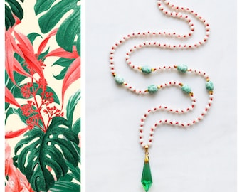 CBN002 - Long boho beaded necklace with emerald green crystal pendant, beige crystals and green jade stones on red cord.