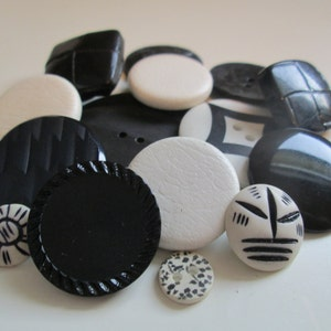 Vintage buttons. Assorted mix of black and white buttons, some white leather covered. Lot of 15 (175)