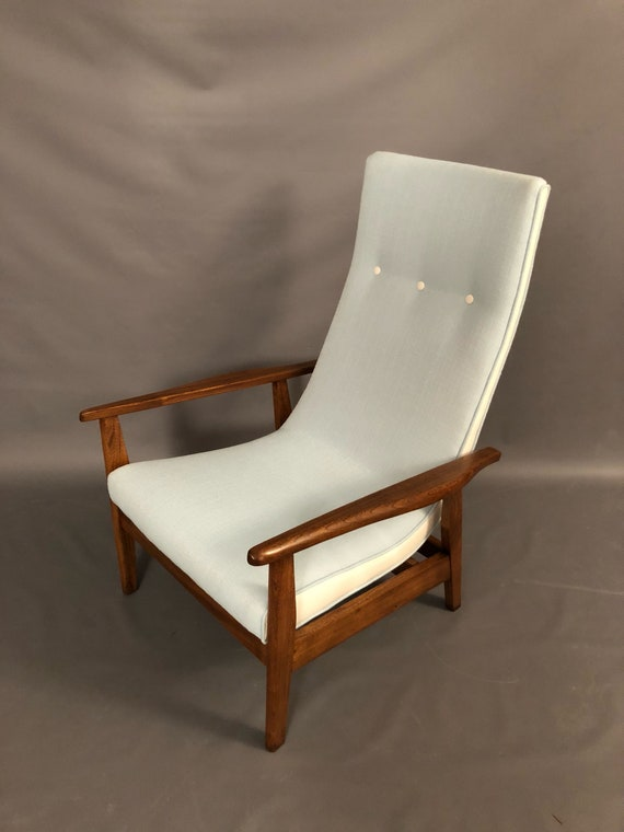 Mid-Century walnut restored Danish arm chair with new baby blue cotton fabric and and white naughyde on the boarders.