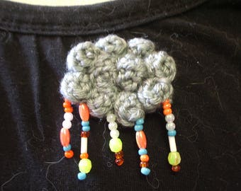 crocheted gray and rainy cloud brooch