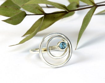 Sterling silver circles ring with hand-set faceted swiss blue topaz, geometric ring, gift for women, alternative December birthstone