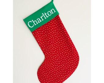 Handmade red Christmas stocking with metallic gold stars