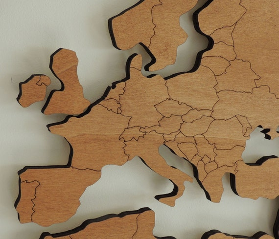 3d wooden world map xl with engraved land borders floating on 3d wooden world map xl with engraved land borders floating on the wall gumiabroncs Images