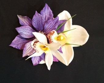 Tropical white orchid with purple flower and white amaryllis. Great for Viva pool party or Tiki Oasis!