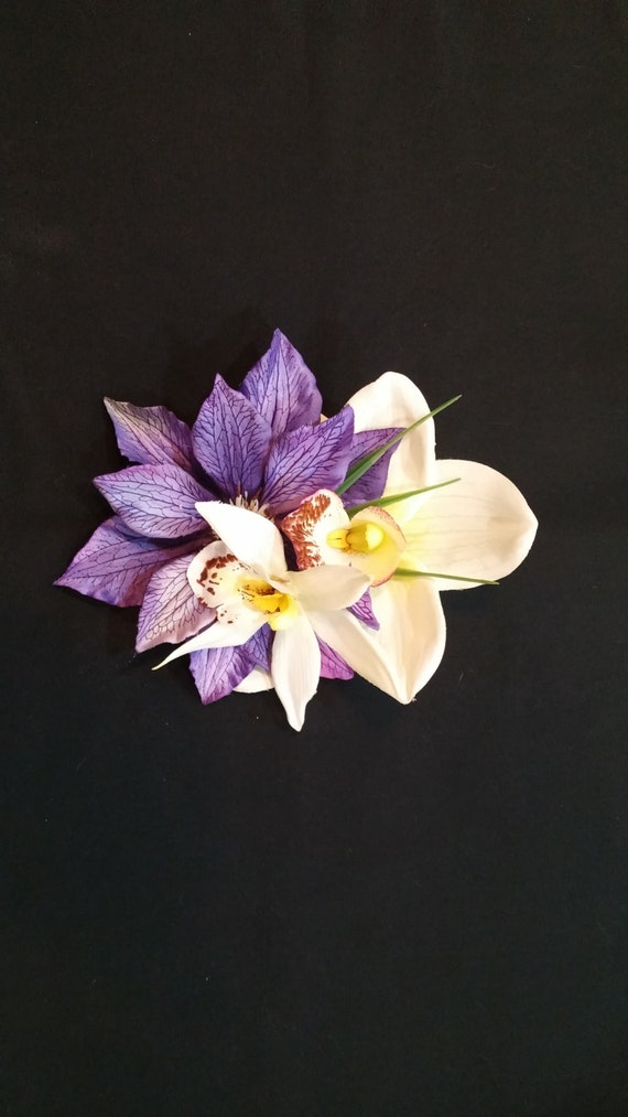 Tropical white orchid with purple flower and white amaryllis.