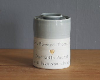 custom baby urn, infant urn. straight shaped urn with custom stamp. modern simple urn for ashes. grey with gold stamp, lid and quote