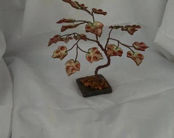 Handcrafted colorful autumn foliage maple tree