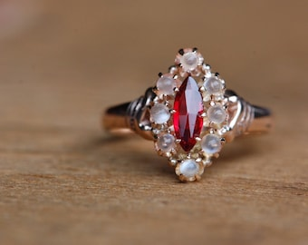 Antique Victorian 10K garnet and moonstone halo dress ring