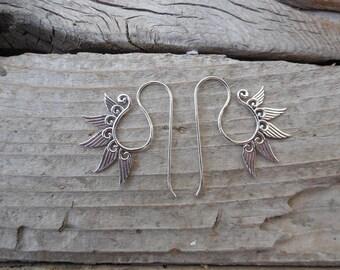 Angel wing earrings handmade in sterling silver
