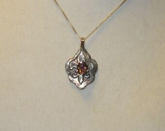 Natural Orange Zircon in Handmade Solid Silver Fleur de Lis Pendant