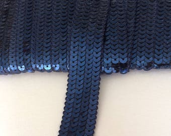 Ribbon has glitter with Navy Blue 4 rows sold from 20 cm round sequins