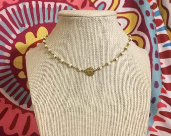 Coin layering necklace in cream