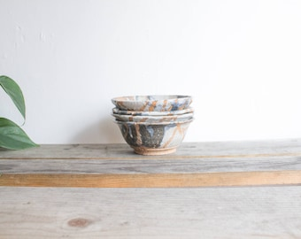 set of 4 multicolor pottery bowls