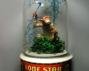 One of a kind 1920 Lone Star Beer Co. mechanical monkey