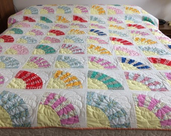 Vintage hand pieced hand quilted 1950 to 1960s yellow/multi colored fan quilt with pinwheel quilting pattern