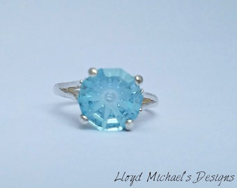 This is a one of a kind cut Blue Topaz Ring set in Sterling Silver.