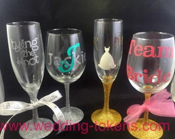 Personalized wine glasses. Your choice of color stem and design.