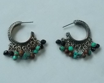 Silver tone post earrings with turquoise, black and brown dangles. (558)