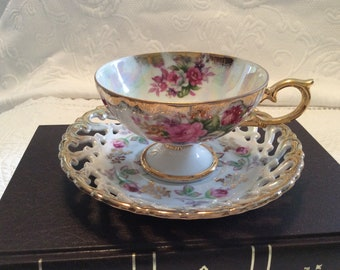 Vintage pedestal cup and pierced saucer porcelain with pink roses