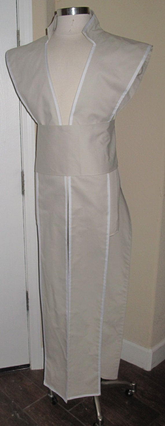 Galen Marek winter white sleeveless collar tunic tabard vest with white trim and a sash