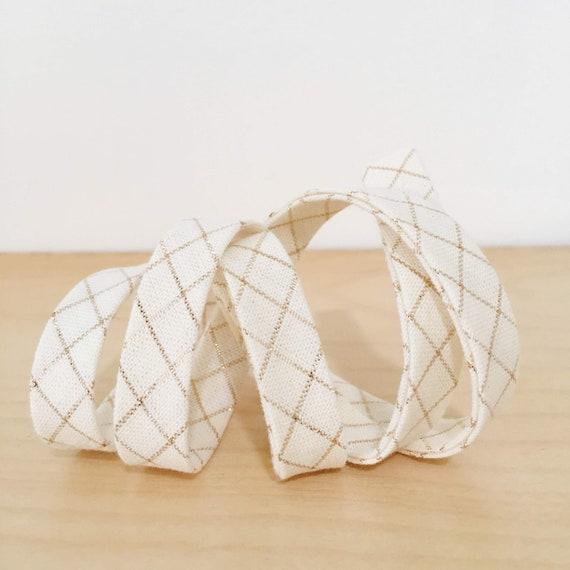 "Bias Tape in Anna Maria Horner's Loominous Illuminated Graph in Metallic Cream 1/2"" double-fold bias tape- 3 yard roll"