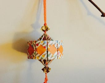 Lantern suspended for Chinese new year in orange origami