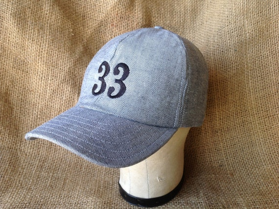 Reversed denim 6 panel cap with embroidered numbers or letters, cotton sweatband, custom colors and cap sizes.