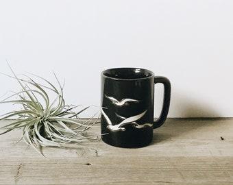 Vintage dark glaze mug with white seagulls