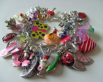 Girls, childrens jewellery, Loaded , charm Bracelet,  heart, ladybird, butterfly, by NewellsJewels on etsy,