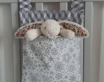 Baby room storage. Cotton fabric home decor. Cot or crib side organizer. Stroller bag. Pram caddy organiser. White and grey snow flakes