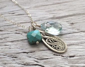 Sterling silver charm necklace with turquoise and quartz gemstone charms