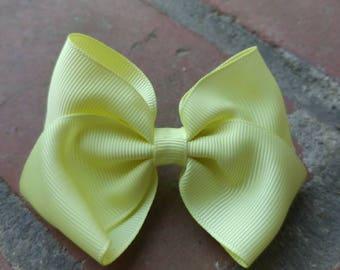 Medium light yellow hair bow. Light yellow hair bow. Light yellow bow. Medium yellow bow. Light yellow bow. Hair bow. Yellow hair bow. Bow