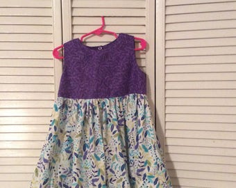 Summer dress in purple, green and turquoise