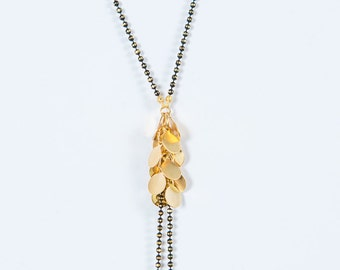 Cluster of gold, gold & black ball chain necklace, necklace is Lariat Necklace