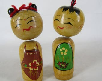 Vintage pair Kokeshi bobble headed wood Japnese dolls
