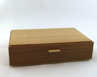 Jewelry box in cherry wood  12 X 7 3/4 x 3 1/8.Top is made from vertica lgrain ( quarter cut )