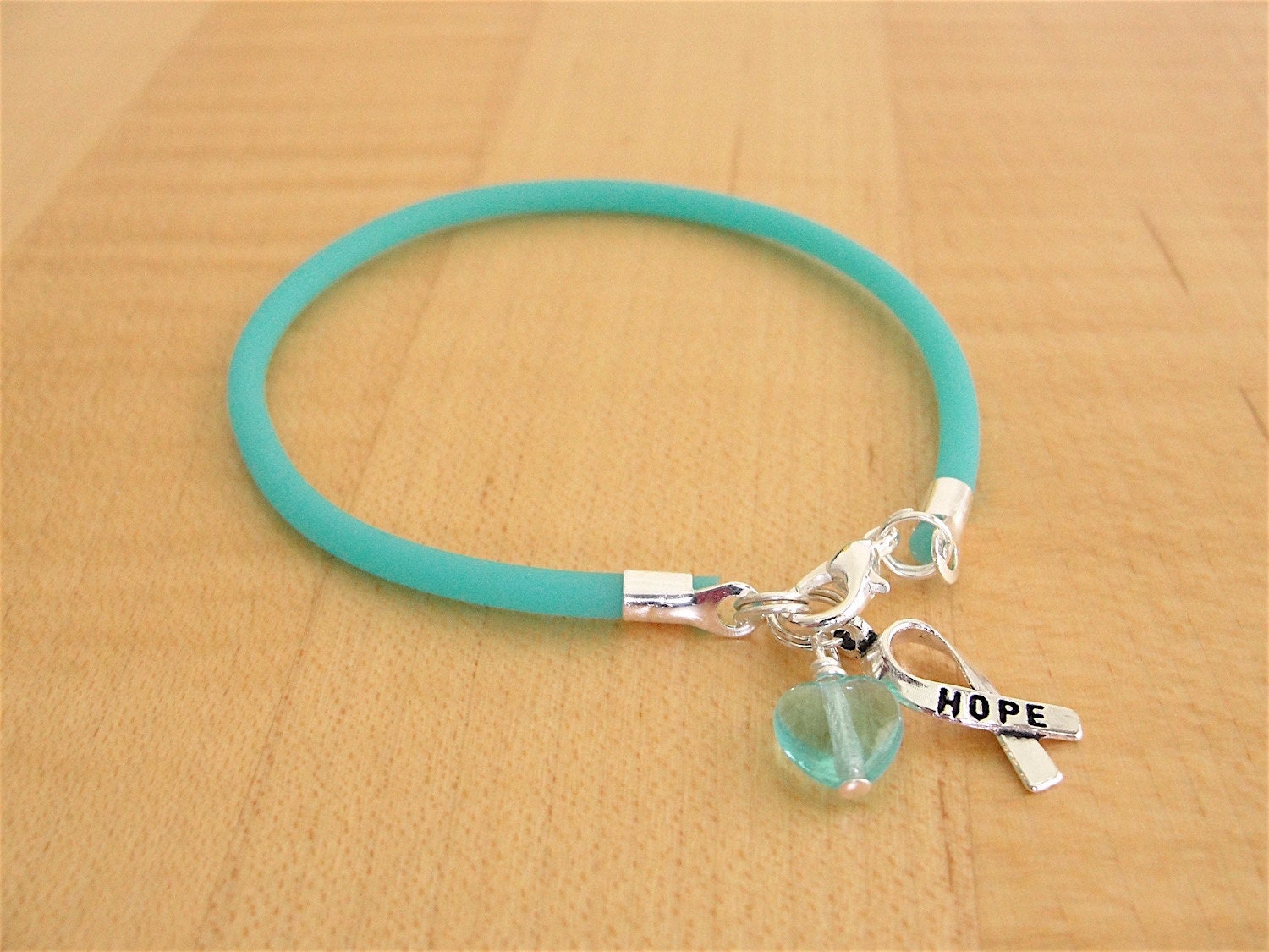 awareness bracelet ribbon on teal representation waterinu gravis art by myasthenia