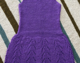 A hand knitted, purple color dress