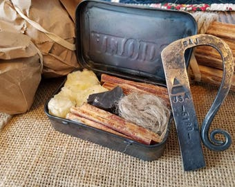 Hand forged flint and steel fire making kit.