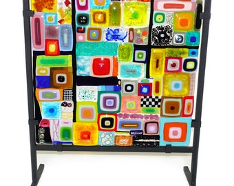 Colorful fused glass window, handmade of the most beautiful types of glass. Exclusive handmade glass panel with metal standing