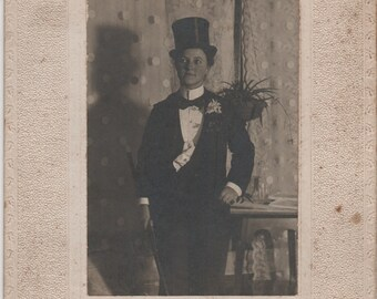 Antique Photograph of Woman Wearing a Tuxedo and Top Hat