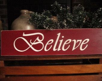 Believe sign handpainted on pine