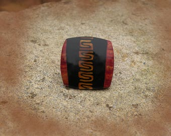 Ethnic copper and gold square ring.