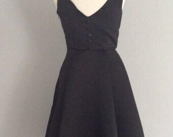 Audrey hepburn inspired v-shaped back fit and flare dress
