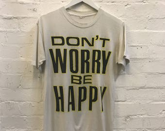 RARE 80s 90s 'Don't Worry Be Happy' Logo Catchphrase Distressed Tee T-shirt