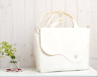 Elegant tote bag in creamy white linen and white canvas with printed foliage lining. Everyday purse