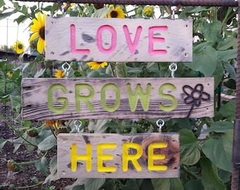 Love Grows Here Garden Sign