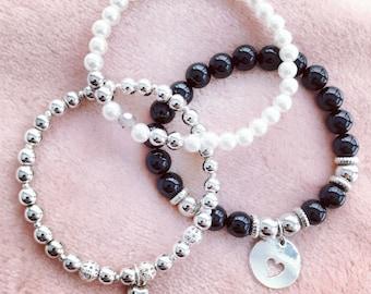 Trio of bracelets with love