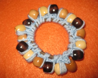 Crocheted light blue hairband with wooden beads
