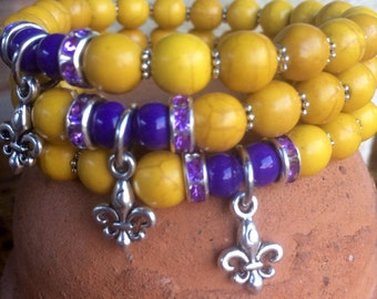 LSU themed stretch bracelet. Fleur de lis charm yoga bracelet with yellow howlite, purple glass beads and metal charm